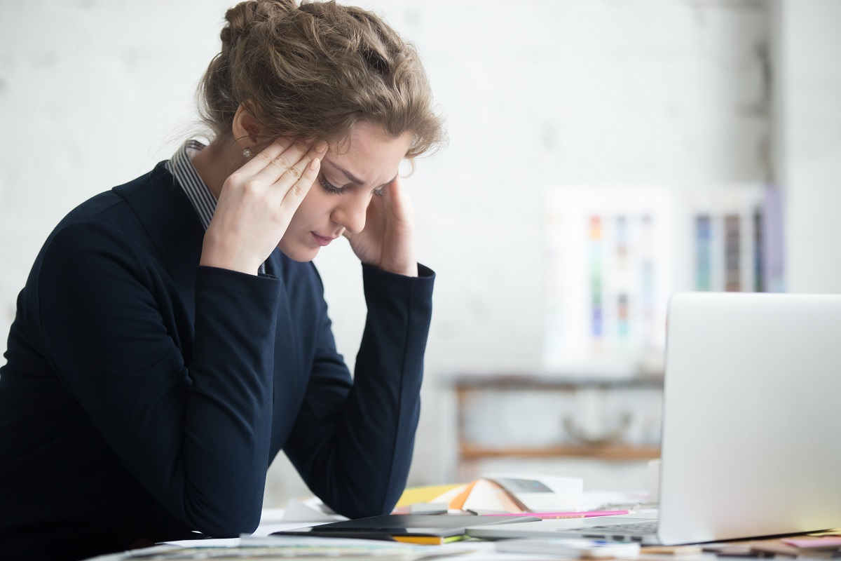 images of a young business women stressed