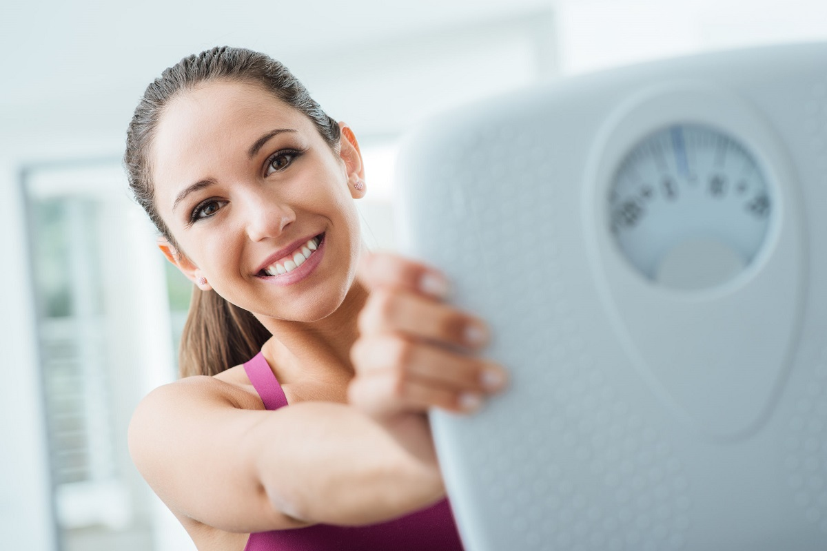 happy young woman losing weight with help of balancemed naturopathic experts