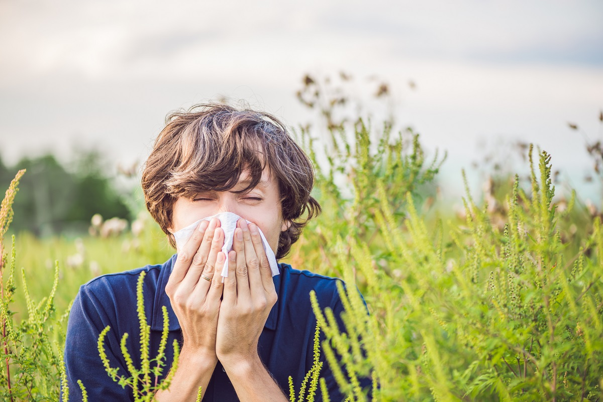 Boy sneezes because of an allergy about to get naturopathy treatment